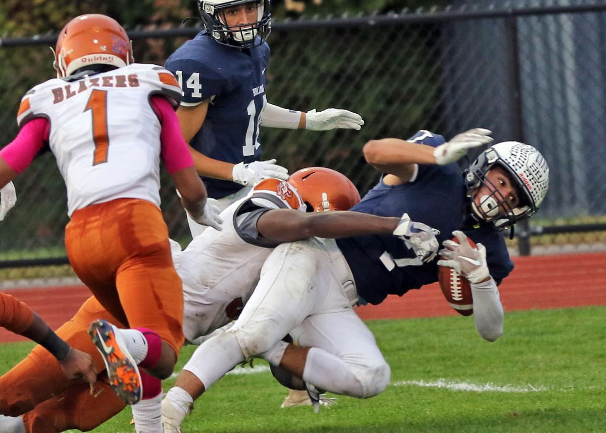Westerly's Rocco Cillino (7) looks towards the goal-line as he is taken down just short of the ten yard line during the Westerly Bulldogs vs Hartford Capital Prep Trailblazers boys varsity football game played Friday afternoon, October 25th, 2019, at Westerly High School's Augeri Athletic Field, Westerly, RI. Teammate Nick Lauzon watches on. | Jackie L. Turner, Special to The Sun.