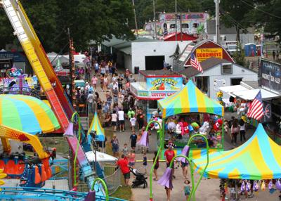 Visitors to the 53rd Annual Washington County Fair stroll