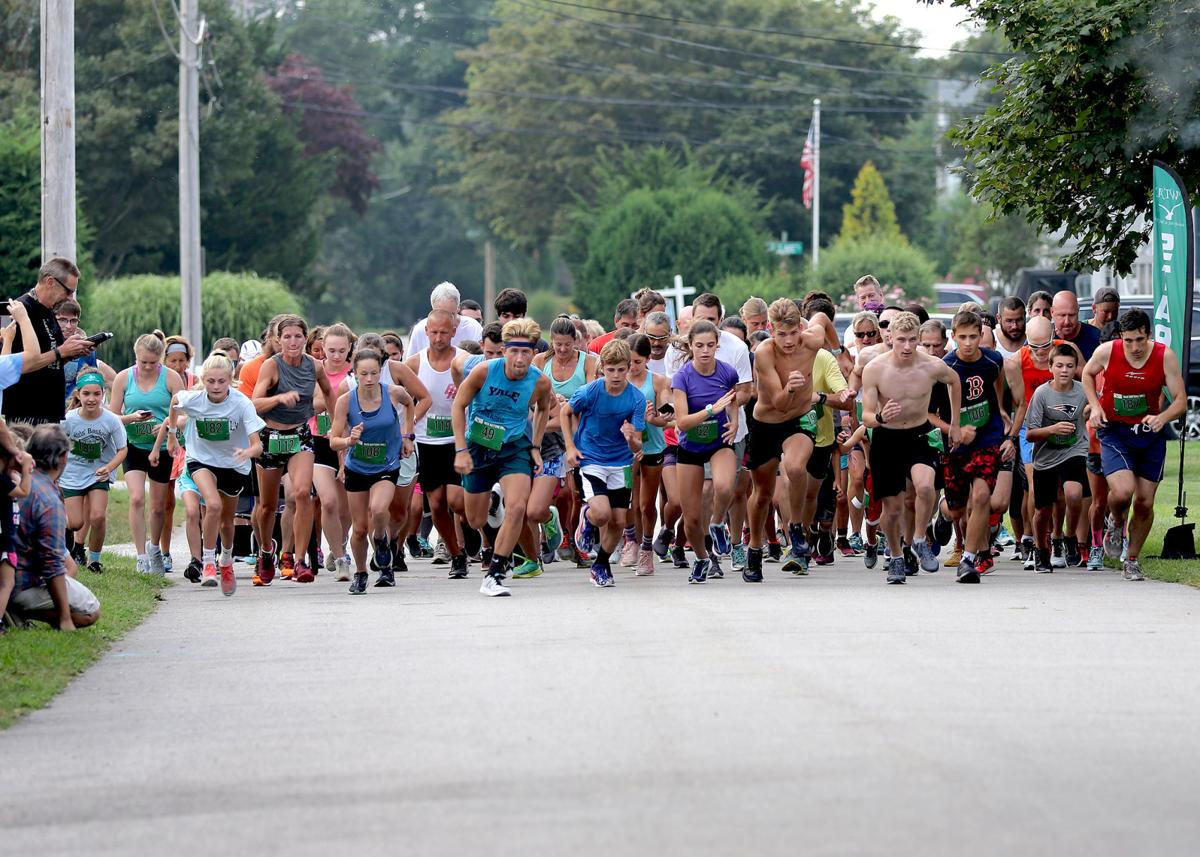 Competitors of all ages leave the starting line of the Nick Battone Mile, a measured mile footrace held Wednesday evening, August 14th, 2019, in Misquamicut.   Jackie L. Turner, Special to The Sun.