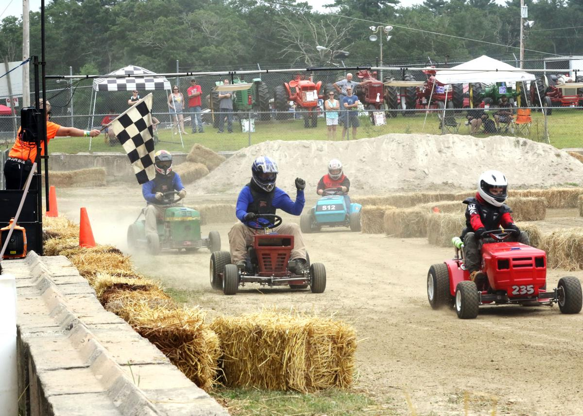 Highly modified lawn tractors race