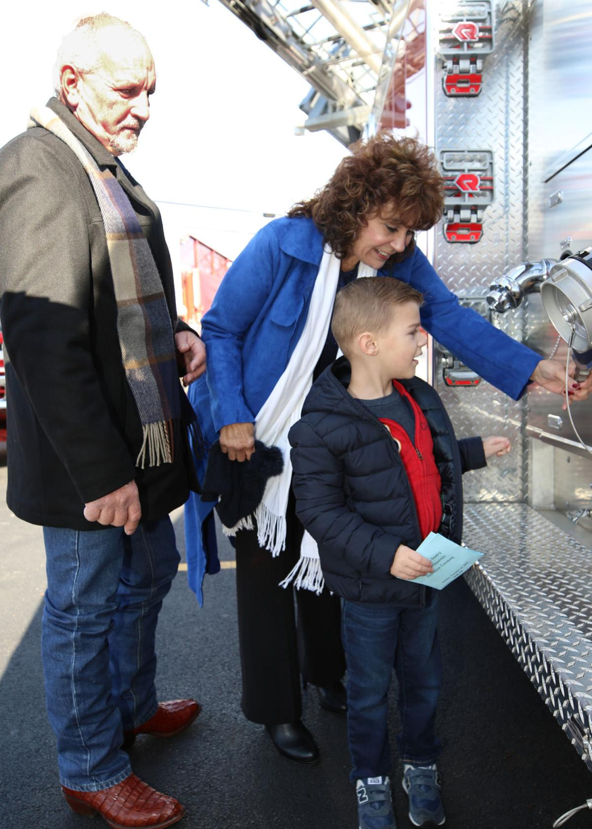 Lorraine and Harold Harrington enjoy watching their grandson J.R. LaPlante marvel at one of the many fire trucks on display during the Frederick A. Stanley Fire Headquarters Dedication Ceremony held Saturday, November 24th, 2018, at the Hope Valley Fire Department in Wyoming, RI. The Harrington family, owners of Shipman's Fire Equipment in Waterford, CT, have been good friends with Chief Stanley for many years and first met him when he wandered into their business to buy firefighting equipment. | Jackie Turner, Special to the Sun.