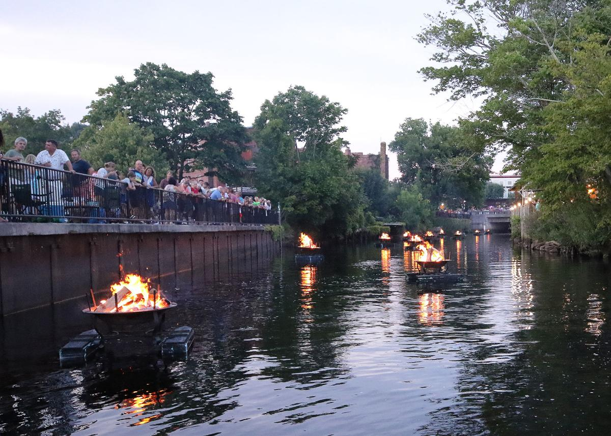 Folks in Pawcatuck's Donahue Park enjoy the 19th Annual River Glow
