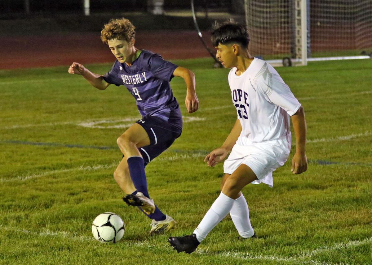 Westerly's Matt Morrone (9) and a Hope opponent vie for ball control during the second half of the Westerly vs Hope High School Division 2 boys varsity soccer game played Tuesday evening, September 14, 2021 at Westerly High School's Augeri Field.   Jackie L. Turner, Special to the Sun.