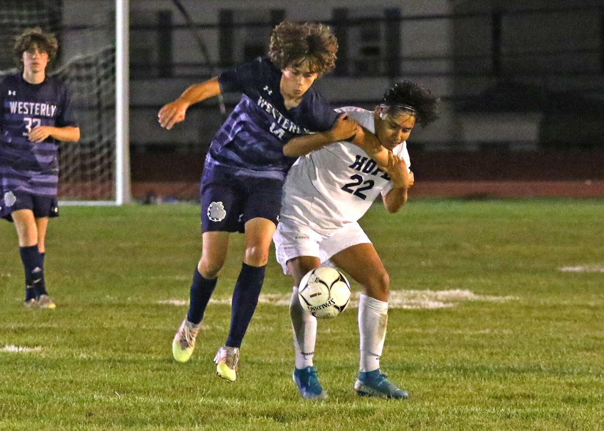 Westerly's Liam Colle (14) and a Hope opponent compete for ball control during the second half of the Westerly vs Hope High School Division 2 boys' varsity soccer game played Tuesday evening, September 14, 2021 at Westerly High School's Augeri Field.   Jackie L. Turner, Special to the Sun.