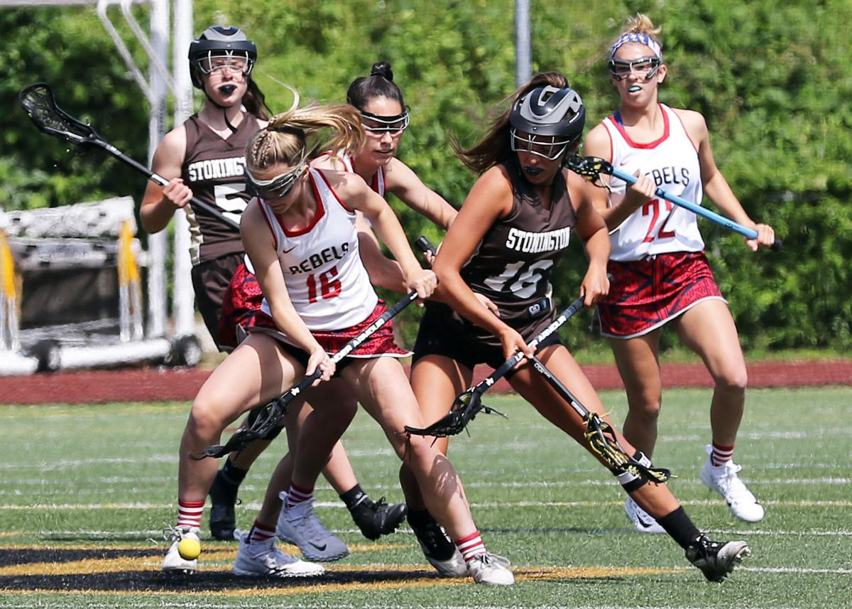 New Fairfield's Eileen Rattigan (16) tries to block the efforts of Westerly's Kate Johnson (16) as she goes after the ball in the Stonington vs New Fairfield girls' varsity lacrosse CIAC Class S Tournament Final on Saturday, June 8th, 2019, at Jonathan Law High School in Milford, CT. | Jackie L. Turner, Special to The Sun.