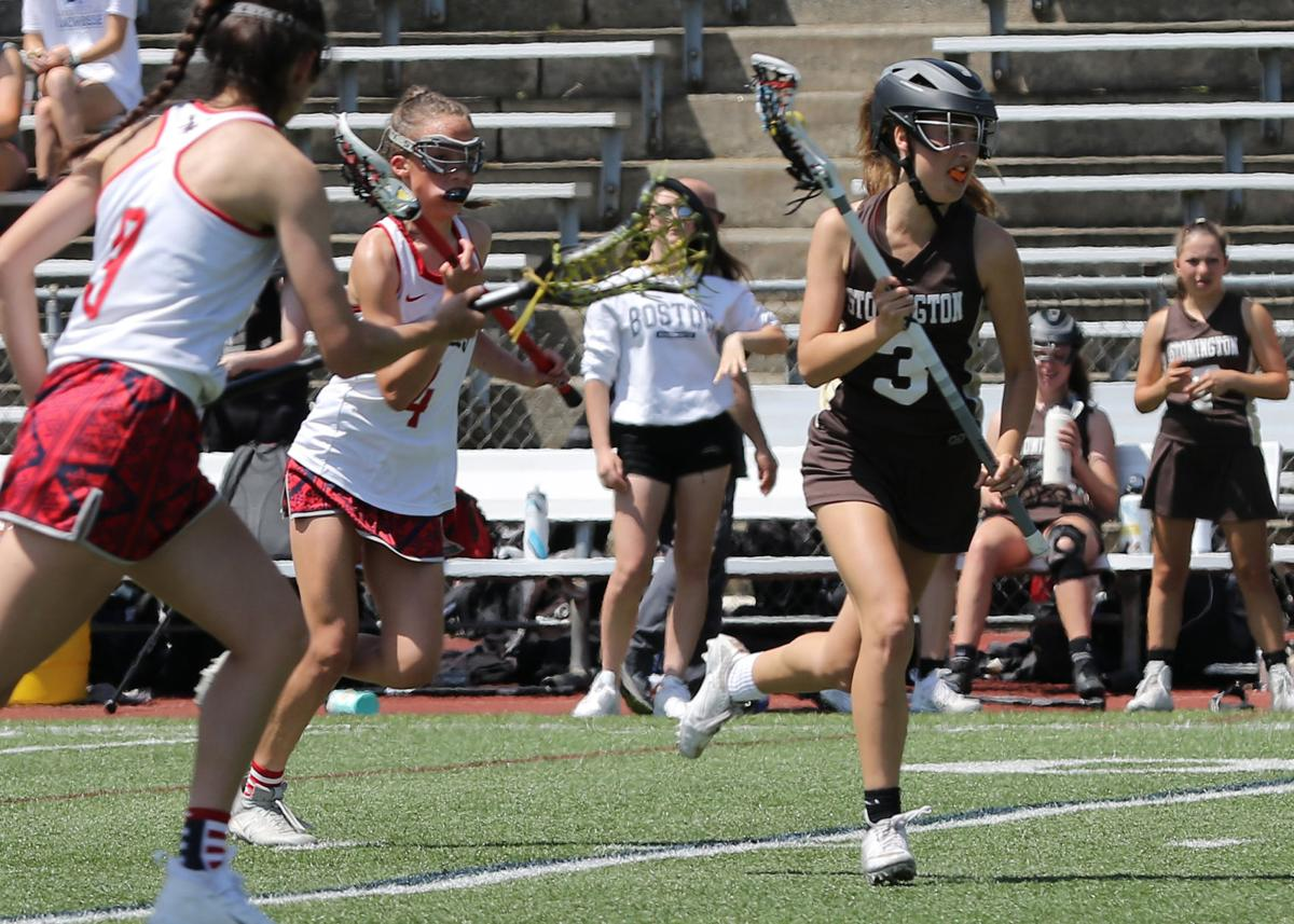 Dillon Griscom (3) looks for a teammate to pass to while being perused by a pair of New Fairfield players during the Stonington vs New Fairfield girls' varsity lacrosse CIAC Class S Tournament Final on Saturday, June 8th, 2019, at Jonathan Law High School in Milford, CT. | Jackie L. Turner, Special to The Sun.