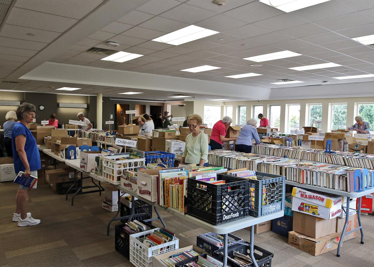 Friends of Westerly Library members unpack hundreds of books from dozens of boxes on Monday morning, July 8th, 2019, as they prepare for their summer book sale. The annual event is open to the public and runs Wednesday, July 10th through Saturday, July 13th. A special screening is available Tuesday, July 9th, for Friends of Westerly Library members only. | Jackie Turner, Special to The Sun.