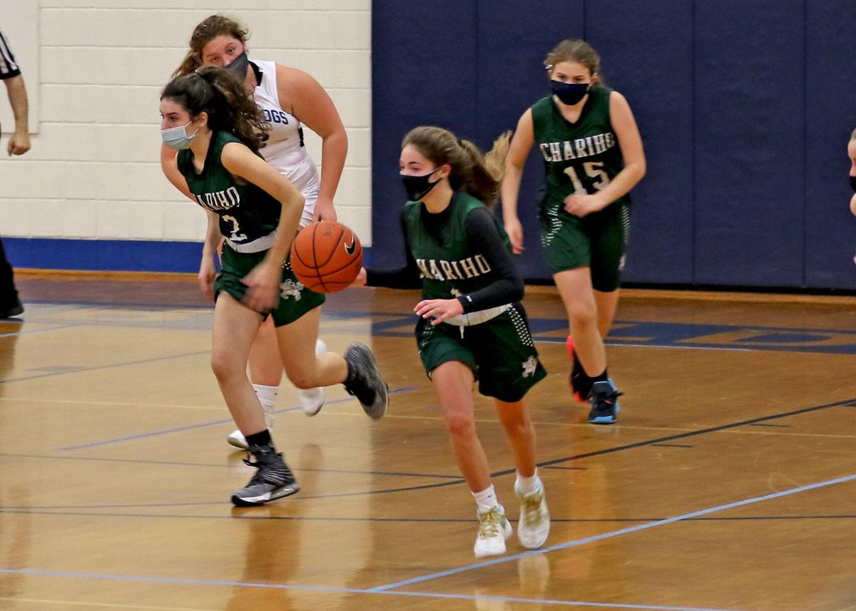 Spencer Shiels (1) starts the ball up court for Chariho along with teammates Keira Frias (left) and McKenzie Allen (right) during the second half of the Westerly vs Chariho gilrs varsity RIIL DIV-II basketball game played Saturday afternoon, February 6, 2021, at Westerly High School. | Jackie L. Turner, Special to The Sun.