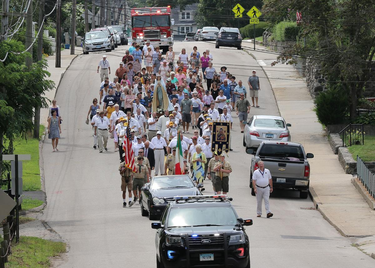 The St Michaels Feast of Maria Assunta procession, led by a Stonington police cruiser and followed by a Pawcatuck fire truck, makes its way down Pawcatuck's Stillman Avenue on Sunday, August 18th, 2019. The event is now in its 99th year.   Jackie Turner, Special to The Sun.