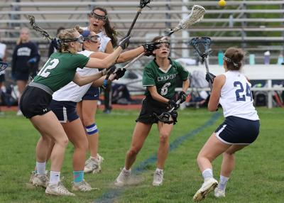 Westerly's Grace Armstrong (24) vies for a loose ball with Chariho's Layne Hart (6) in the Westerly vs Chariho girls' varsity lacrosse game played May 10th, 2019, at Westerly High School's Augeri Field.   Jackie L. Turner, Special to The Sun.