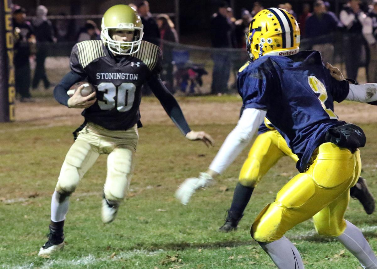 Chase Gouvin carries for Stonington in the 14U youth football game against Ledyard on Sunday evening, November 18th, 2018 at Crandall Field, Gales Ferry, CT. | Jackie L. Turner, Special to The Sun.