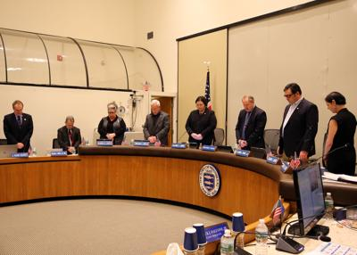 Westerly town council members bow their heads in remembrance of recently passed former town council member Mario Celico. The council gathered at the town hall Monday evening, January 7th, 2019 for the promotion and swearing in ceremony of eight Westerly police officers. | Jackie L. Turner, Special to the Sun.