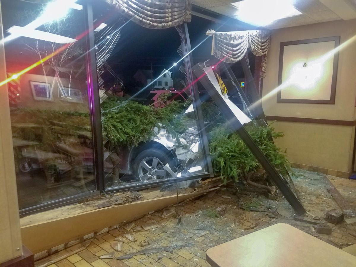 Westerly police, fire and ambulance personnel assisted in response to the Burger King on Franklin Street Saturday night after a car crashed through the window. An investigation determined the crash was an accident. No one was injured and police said no charges are expected. Courtesy Westerly Police Department