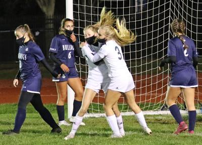 Brooke Kanaczet (9) scores the second Chariho goal of the evening and is congratulated by teammate Tessa Azzinaro (3) during the first half of the Westerly vs Chariho girls varsity soccer game played Saturday evening, October 31, 2020, at Westerly High School's Augeri Field.   Jackie L. Turner, Special to The Sun.