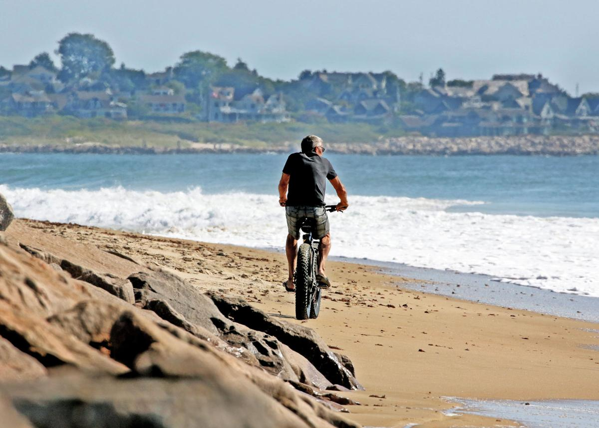 092019 WES Cyclist rides along beach 1228.JPG