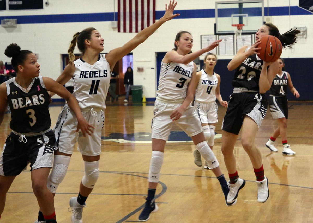 Stonington's Miranda Arruda (20 ) lays up for a basket against South Kingstown while teammate Aliza Bell (3) looks on. The Stonington Bears girl's varsity basketball team took on the South Kingstown Rebels in the 35th Annual WCCU Holiday Basketball Tournament girls playoffs on Thursday evening, December 27th, 2018 at Westerly High School. | Jackie L. Turner, Special to The Sun.