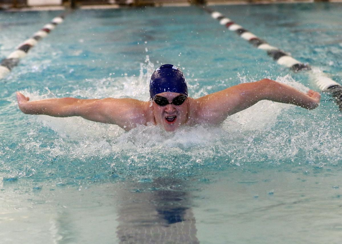 Westerly's Madigan Hiltz swims the butterfly in the 200 meter individual medley during the Westerly Bulldogs vs North Providence Cougars boys RIIL DIV-II Swimming Finals held Saturday afternoon, March 6, 2021, at the PODs Swimming Aquatic Center in East Providence, RI.   Jackie L. Turner, Special to The Sun.