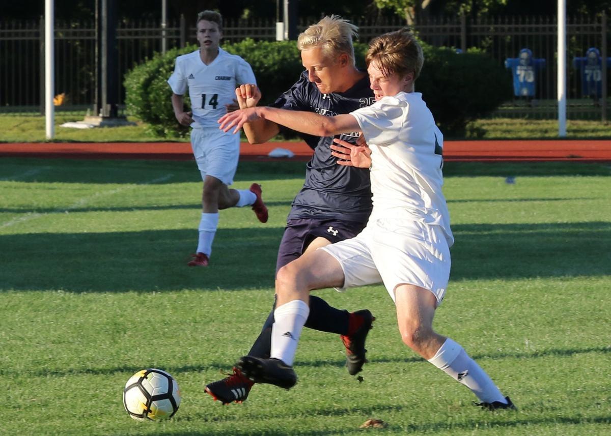 Chariho's Andrew Poirier (4) and Westerly's Nathaniel Ober (25) vie for ball control during the first half of the Westerly vs Chariho boys' varsity soccer game played Tuesday evening, September 3rd, 2019, at Westerly High School's Augeri Field. | Jackie L. Turner, Special to The Sun.