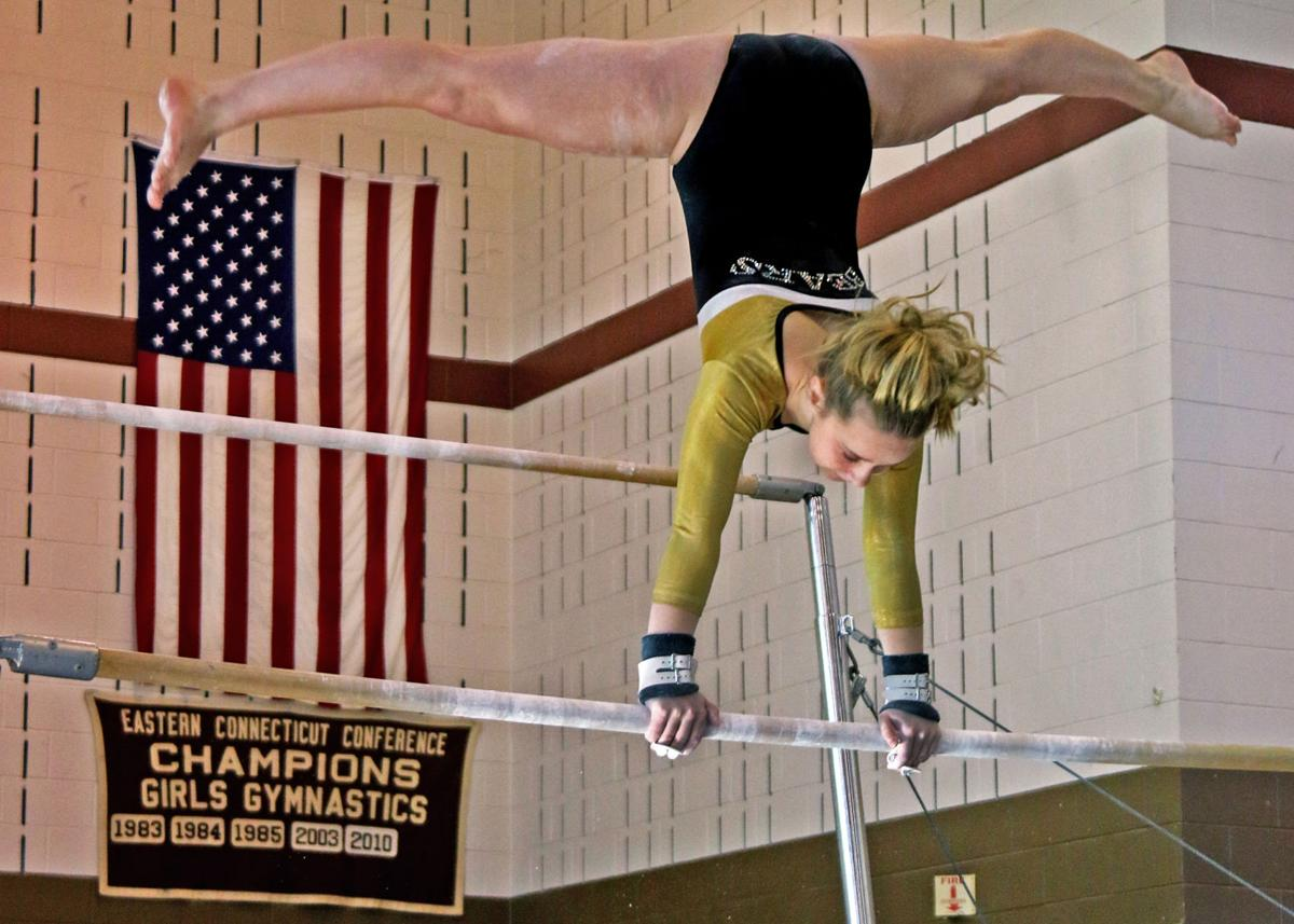 Stonington's Hanna Laskey performs on the uneven bars during a meet with NFA in January. Laskey was an All-State performer and a New England qualifier for the Bears this season.