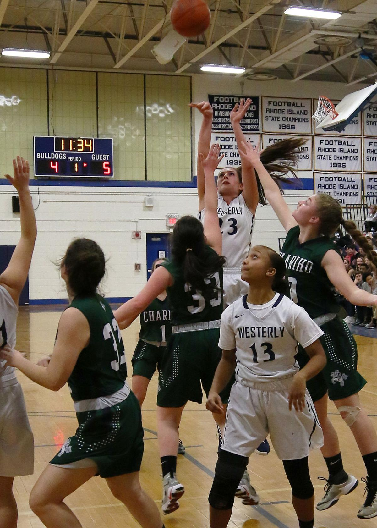 Westerly's Megan Albamonti (23) shoots from just outside while teammate Isis Hamelin (13) looks on. The Westerly Bulldogs girls' varsity basketball team took on the Chariho Chargers on Wednesday evening, February 20th, 2019, at Westerly High School. The evening's game was the last in the girls' Division II regular season. | Jackie L. Turner, Special to The Sun.