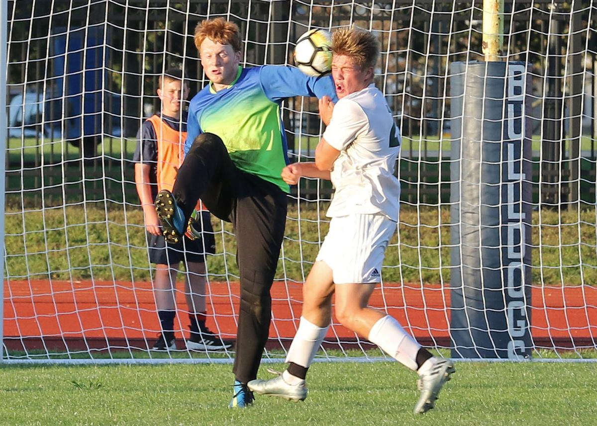 Chariho's Jason Nilsson (25) tries to shield himself from a ball cleared by Westerly goalie John Healy in the Westerly vs Chariho boys' varsity soccer game played Tuesday evening, September 3rd, 2019, at Westerly High School's Augeri Field. | Jackie L. Turner, Special to The Sun.