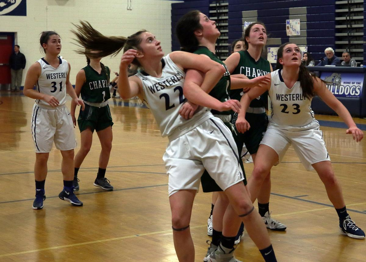 Emily Haik (22) and Megan Albamonti (23) look for the rebound along with Chariho's Annaliese Kenney (13-left) and Megan Hill (32-right) in the Westerly vs Chariho Division II girls' varsity basketball game played Wednesday evening, February 20th, 2019, at Westerly High School. | Jackie L. Turner, Special to The Sun.