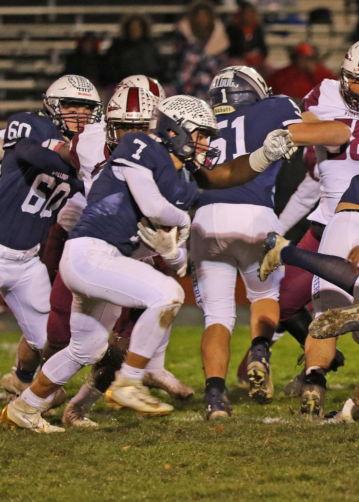 Rocco Cillino (7) runs the ball for Westerly as teammates Zack Moroin (51) and Xavier Webster (6) block during the Westerly vs Woonsocket boys varsity football DIV-II playoff game on Friday evening, November 8th, 2019, at Westerly High School's Augeri Field, Westerly, RI.   Jackie L. Turner, Special to The Sun