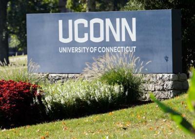 standing Uconn sign