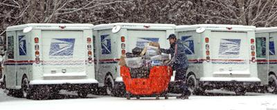 standing mail carriers in snow