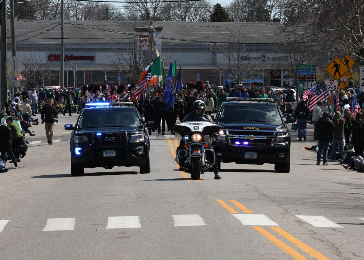 Groton and Stonington Police vehicles roll down Mystic's East Maine Street at the front of the 16th Annual Mystic Irish Parade on Sunday, March 24th, 2019. | Jackie Turner, The Westerly Sun.