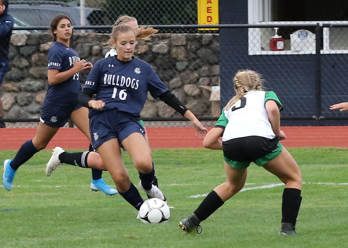 Jillian Octeau (16) dribbles around Lincoln's Sarah Leonetti (5) as Westerly teammate Madeline Faubert (10) watches on. The Westerly Bulldogs girls varsity soccer team hosted the Lincoln Lynx on Friday afternoon, September 6th, 2019 at Westerly High School's Augeri Field. | Jackie L. Turner, Special to The Sun.