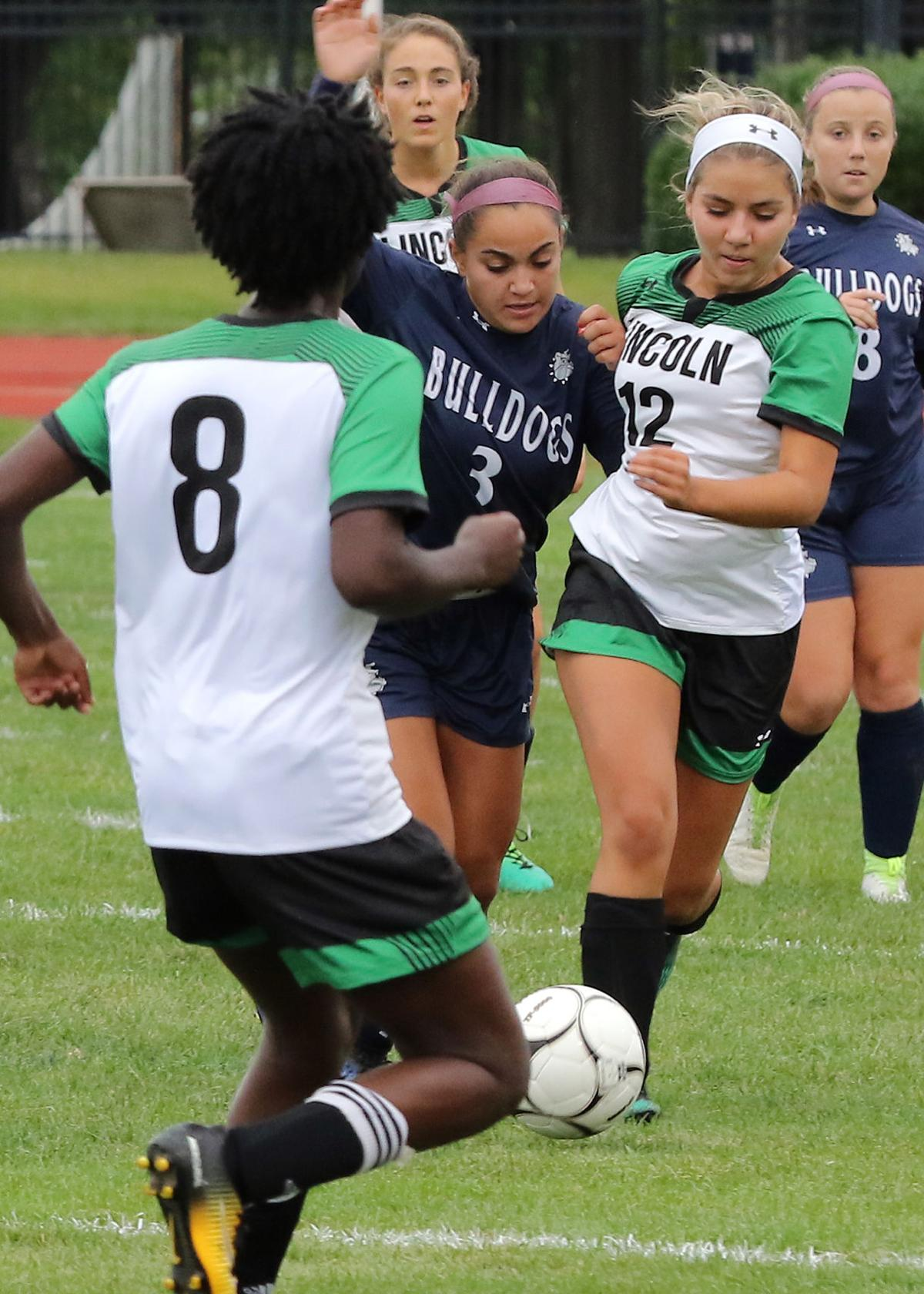Westerly's Diana Turano (3) vies for control of the ball against Lincoln's Tayla Salome (8) and Julia Perry (12) in the Westerly vs Lincoln girls' varsity soccer game played Friday afternoon, September 6th, 2019 at Westerly High School's Augeri Field. | Jackie L. Turner, Special to The Sun.