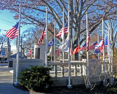 Flags at half staff at Westerly War Memorial for George H.W. Bush