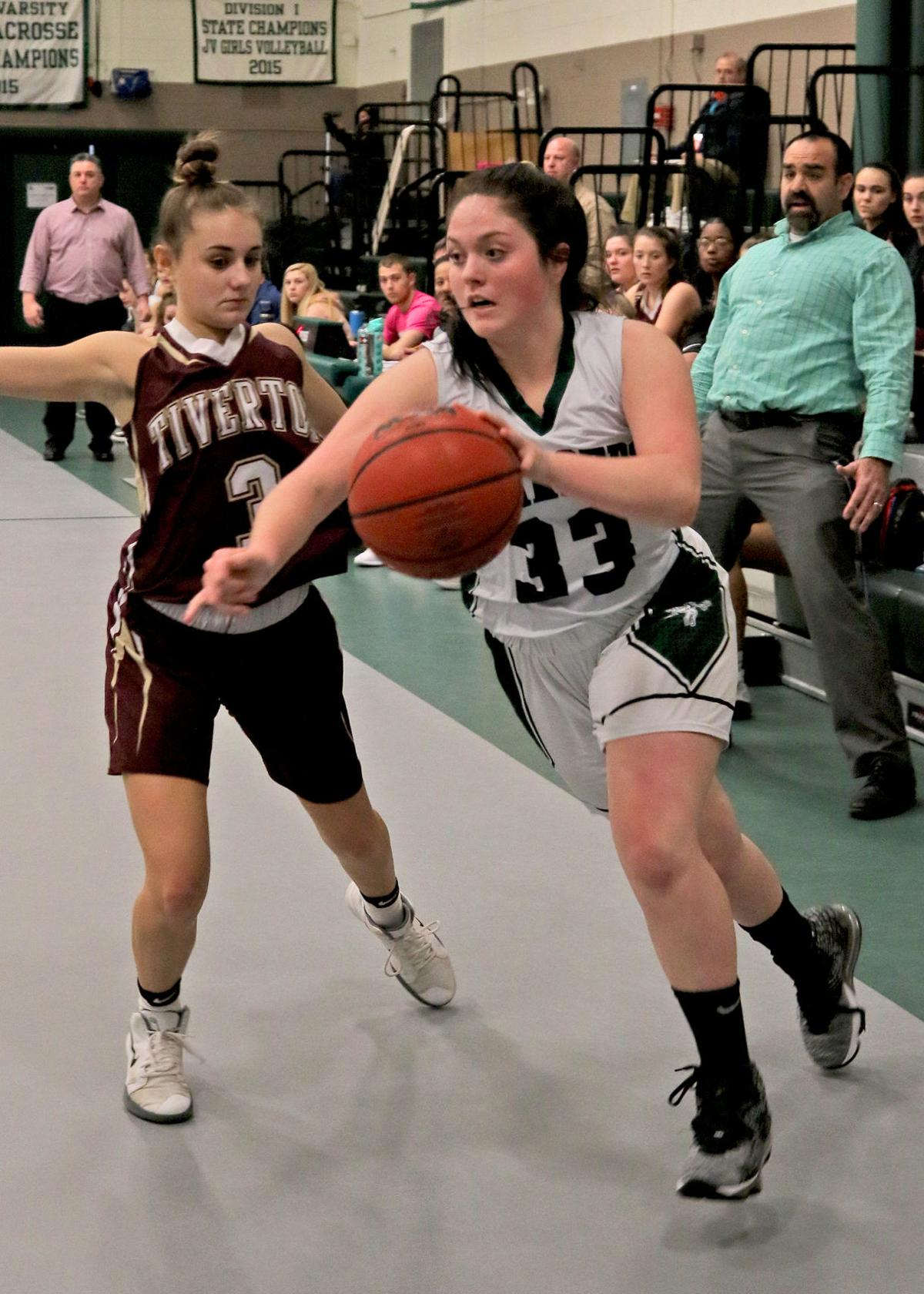 Shelby Roode (33) drives around Tiverton's Marissa Cayer (3) on her way to the basket for Chariho. The Chariho Chargers girls' varsity basketball team played the Tiverton Tigers in the EIIL DIV-II preliminary playoff game on Friday evening, February 28, 2020 at Chariho High School, Wood River Junction, RI. | Jackie L. Turner.