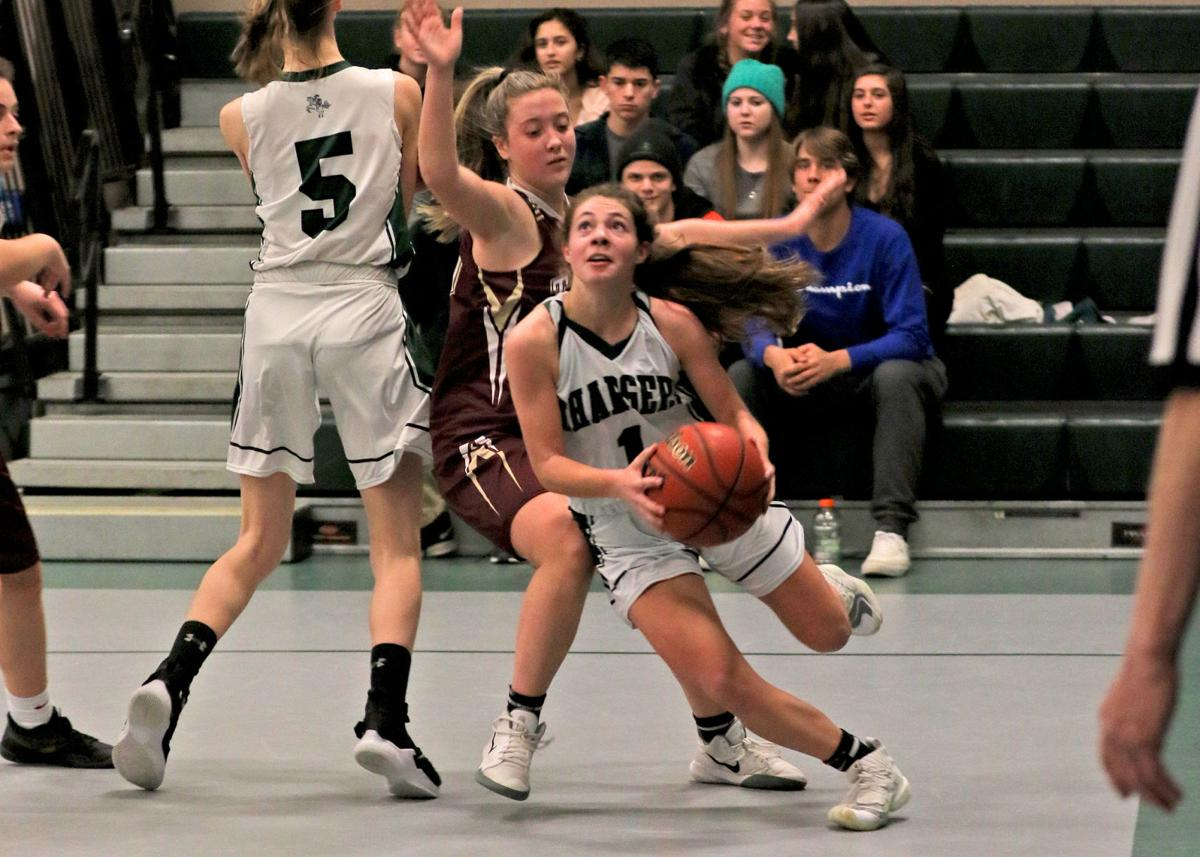 Chariho's Spencer Shiels (1) cuts around Tiverton's Mariah Ramos (21) on her way to the basket during the first half of the Chariho Chargers vs Tiverton Tigers EIIL DIV-II preliminary playoff game played Friday evening, February 28, 2020 at Chariho High School, Wood River Junction, RI. | Jackie L. Turner.