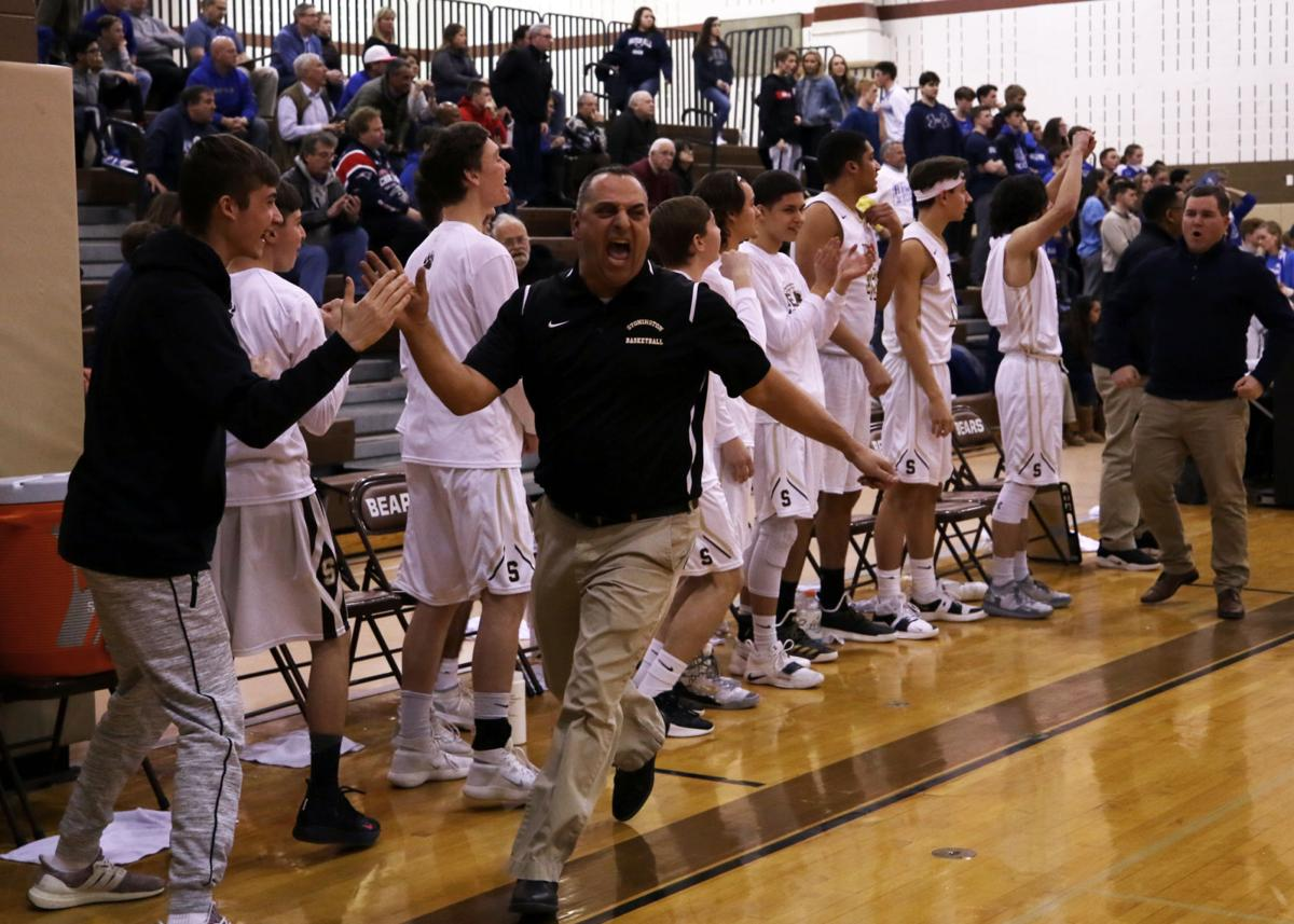 Coach John Luzzi throws a high five shortly before the Bears 55 to 49 win against Old Saybrook. The Stonington Bears boys varsity basketball team hosted the Old Saybrook Rams in Division II semi-final playoffs Wednesday evening, March 6th, 2019 at Stonington High School. | Jackie L. Turner, Special to The Sun.