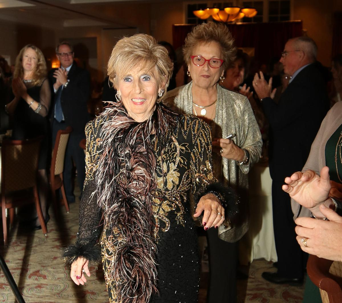 Angie Smith, recipient of the 2019 Athena Award, smiles as she makes her way to the podium at the 17th Annual Athena Awards Banquet was held Wednesday evening, October 23rd, 2019 at the Lake of Isles in North Stonington. | Jackie Turner, Special to The Sun.