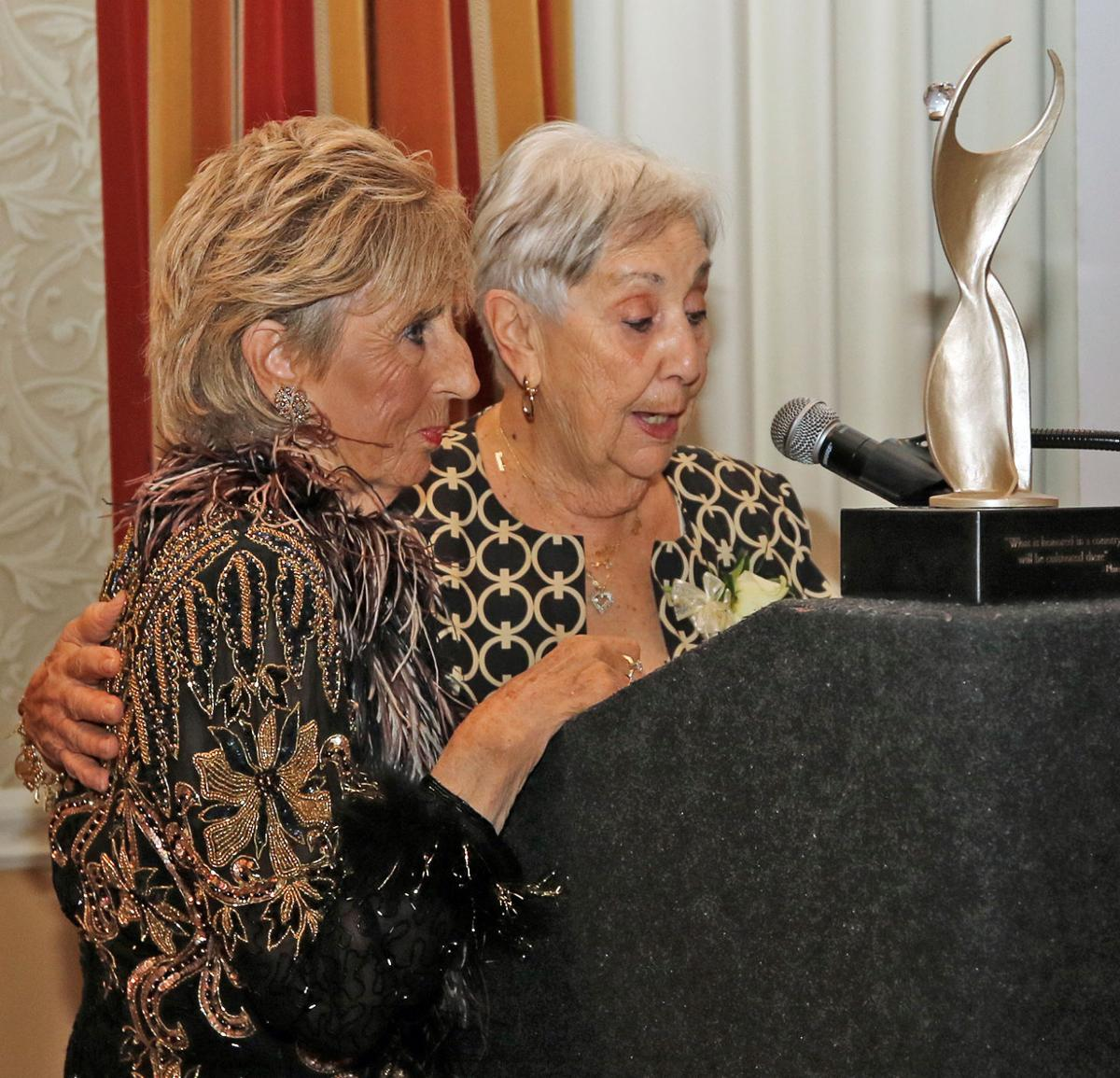 Geraldine Cunningham, President and CEO of First Financial Advisory Services in Westerly, introduces Angie Smith, recipient of the 2019 Athena Award. The 17th Annual Athena Awards Banquet was held Wednesday evening, October 23rd, 2019 at the Lake of Isles in North Stonington. | Jackie Turner, Special to The Sun.