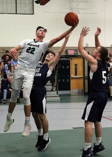 Chariho's Levi King (22) shoots from under the basket in the Chariho vs South Kingstown boys' varsity basketball game played Friday evening, December 13, 2019, at Chariho High School, Wood River, RI.   Jackie L. Turner, Special to The Sun.