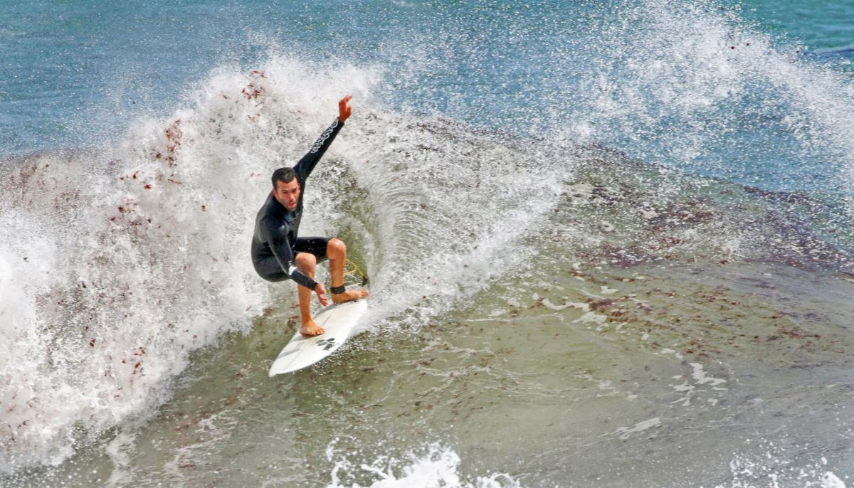 070921 WES Storm Elsa surfers out hh 61044.JPG