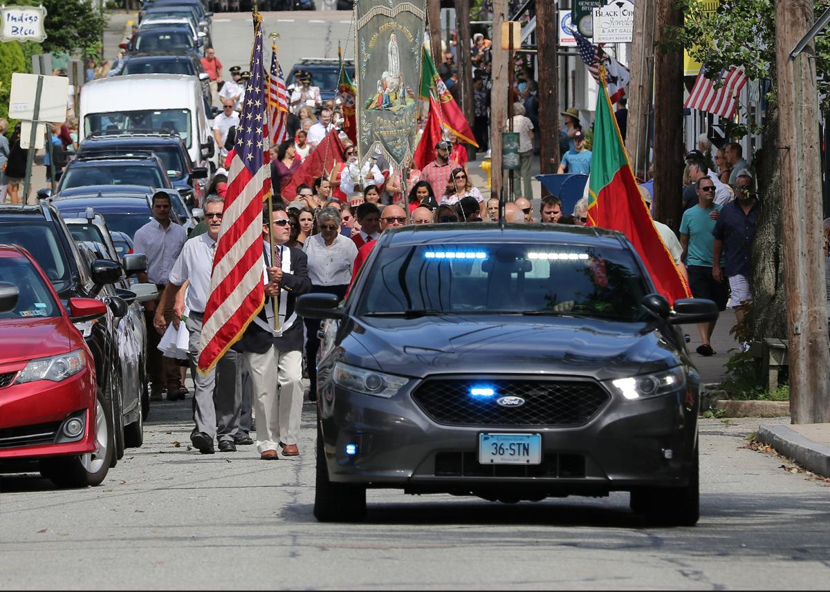 The Feast of the Devine Holy Spirit procession makes its way along Water Street in Stonington Borough on its way back to the Portuguese Holy Ghost Society to honor and pay tribute to the Miracle of the Espirito Santo and Queen St. Isabel of Portugal. The event was held Sunday, September 1st, 2019. | Jackie Turner, Special to The Sun.