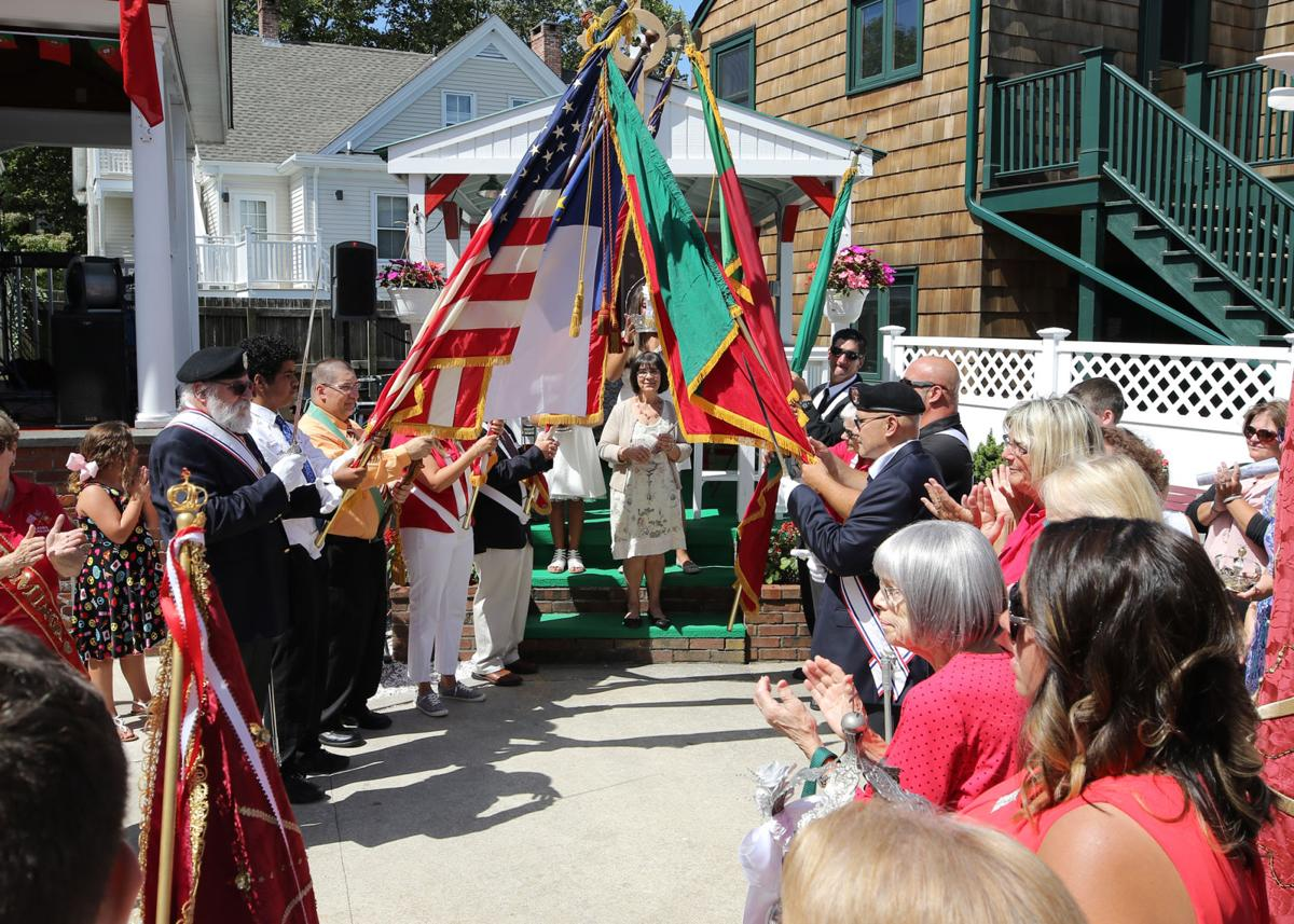 An archway of Portuguese and American flags is formed at Stonington Borough's Portuguese Holy Ghost Society on Sunday, September 1st, 2019, as part of the traditional blessing of the crowns and scepters symbolic of the Holy Spirit. The event was part of a two-day celebration honoring the Miracle of the Espirito Santo and Queen St. Isabel of Portugal. | Jackie Turner, Special to The Sun.