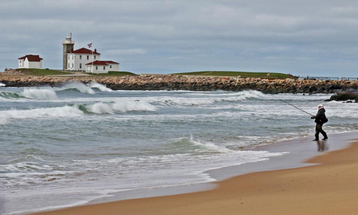 051419 WES East Beach angler near lighthouse 12.JPG