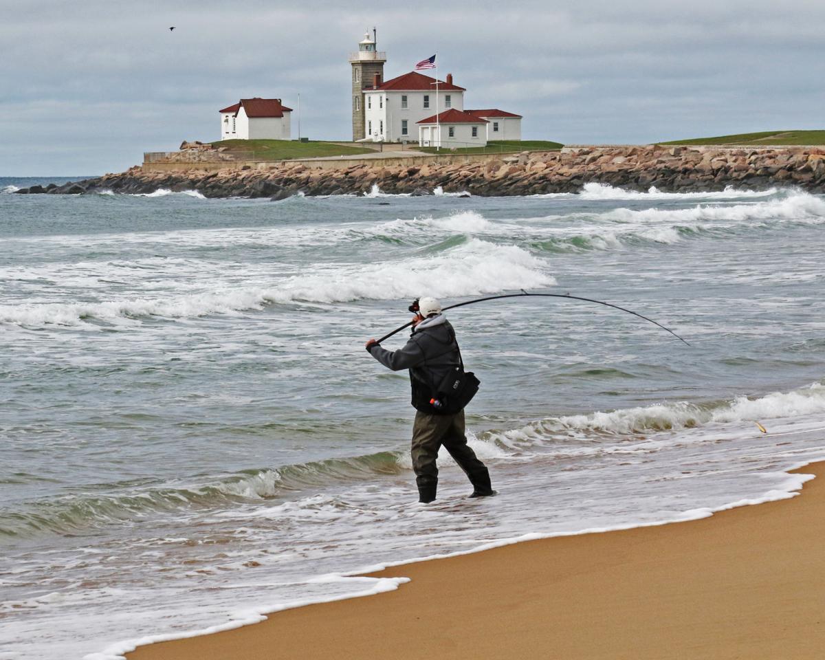 051419 WES East Beach angler near lighthouse 14.JPG