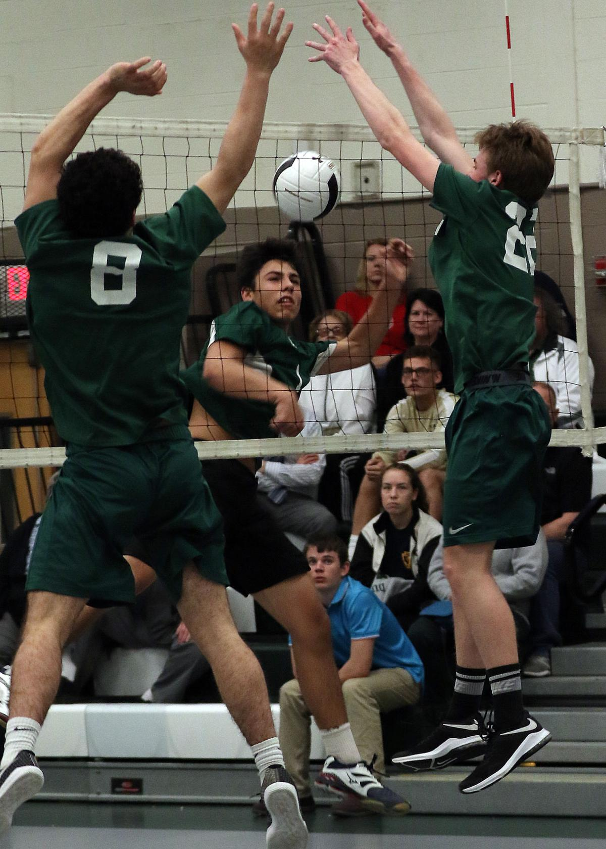 Chariho's Nathaniel Felicetti (1) watches his shot attempt during the Chariho vs Bishop Hendricken boys varsity volleyball game played Thursday evening, April 4th, 2019 at Chariho High School. | Jackie L. Turner, Special to The Sun.