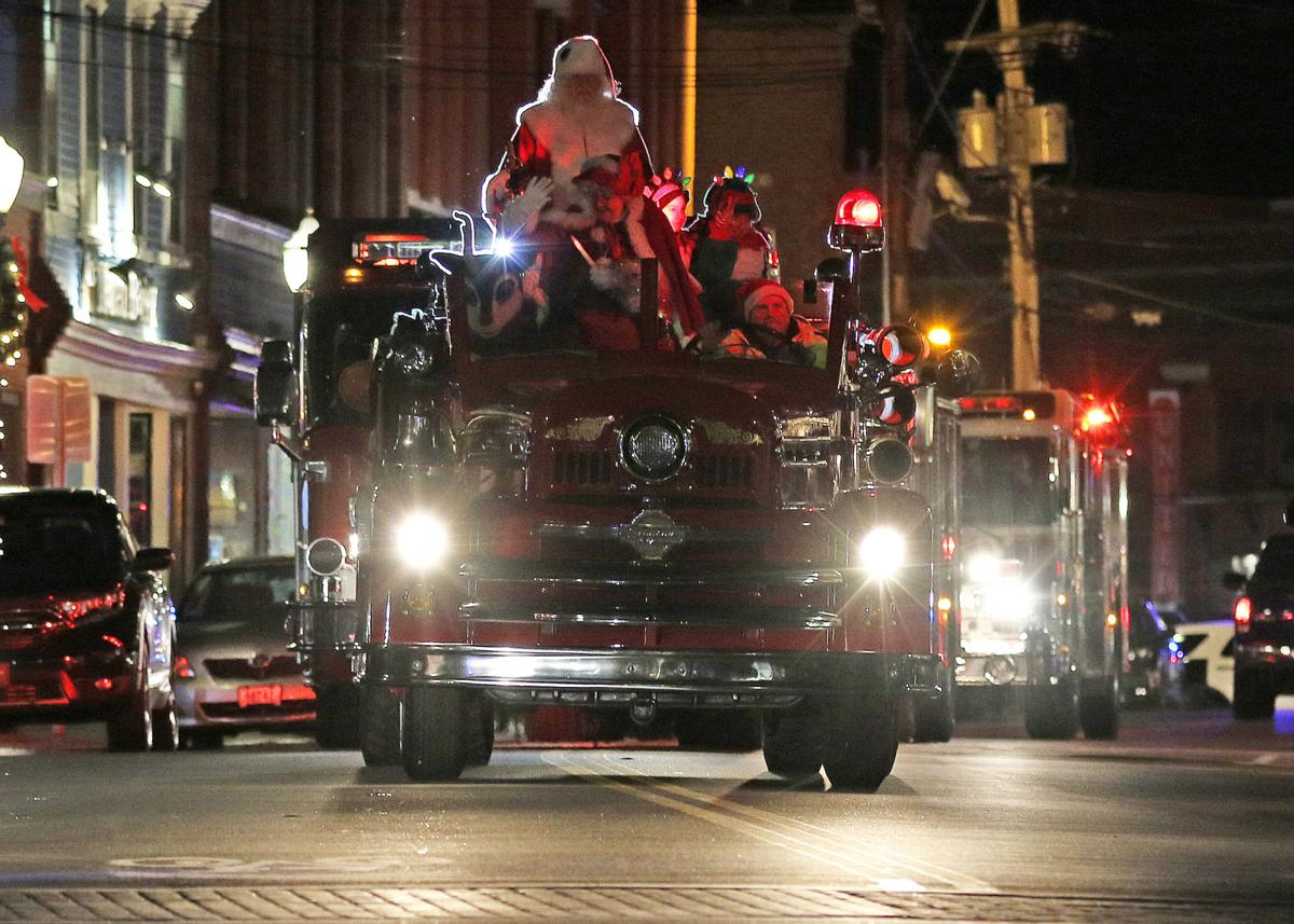 The 2019 Holiday Season was ushered in Friday evening, Nov 29, 2019, as Santa Claus, Winter Lady, and other favorite holiday characters made their way into Westerly's Dixon Square atop Westerly Fire Department's 1953 Seagraves antique fire truck. The popular annual event, sponsored by the Ocean Community Chamber of Commerce, attracts a big crowd and provides a spirited venue for strolling the downtown sidewalks and for having photos taken along side Santa.   Jackie Turner, Special to The Sun.