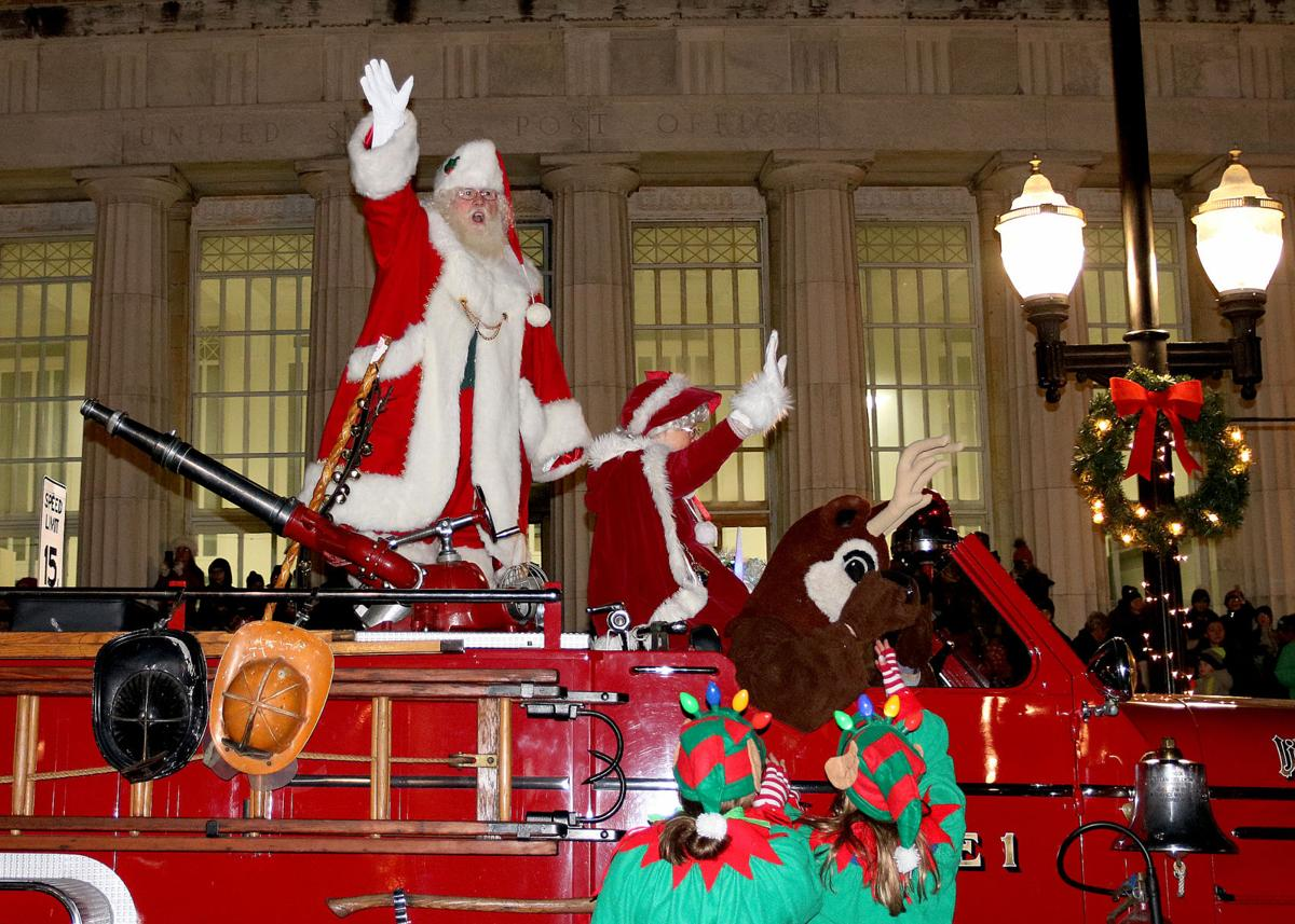 The 2019 Holiday Season was ushered in Friday evening, Nov 29, 2019, as Santa Claus, Winter Lady, and Rudolph the reindeer ride into Westerly's Dixon Square atop the town's 1953 Seagraves antique fire truck. The popular annual event, sponsored by the Ocean Community Chamber of Commerce, attracts a big crowd and provides a spirited venue for strolling the downtown sidewalks and for having photos taken along side Santa. The children love it all!   Jackie Turner, Special to The Sun.