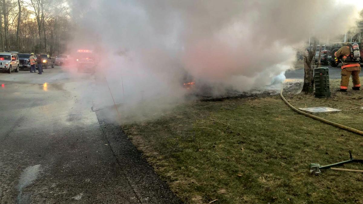Members of the Hope-Valley Wyoming Fire Department doused a fully engulfed car fire Sunday afternoon at a home on Hopkinton Hill Road in Hope Valley. No injuries were reported and firefighters were able to prevent the fire from extending beyond the vehicle. Courtesy Hope Valley-Wyoming Fire Department via Facebook