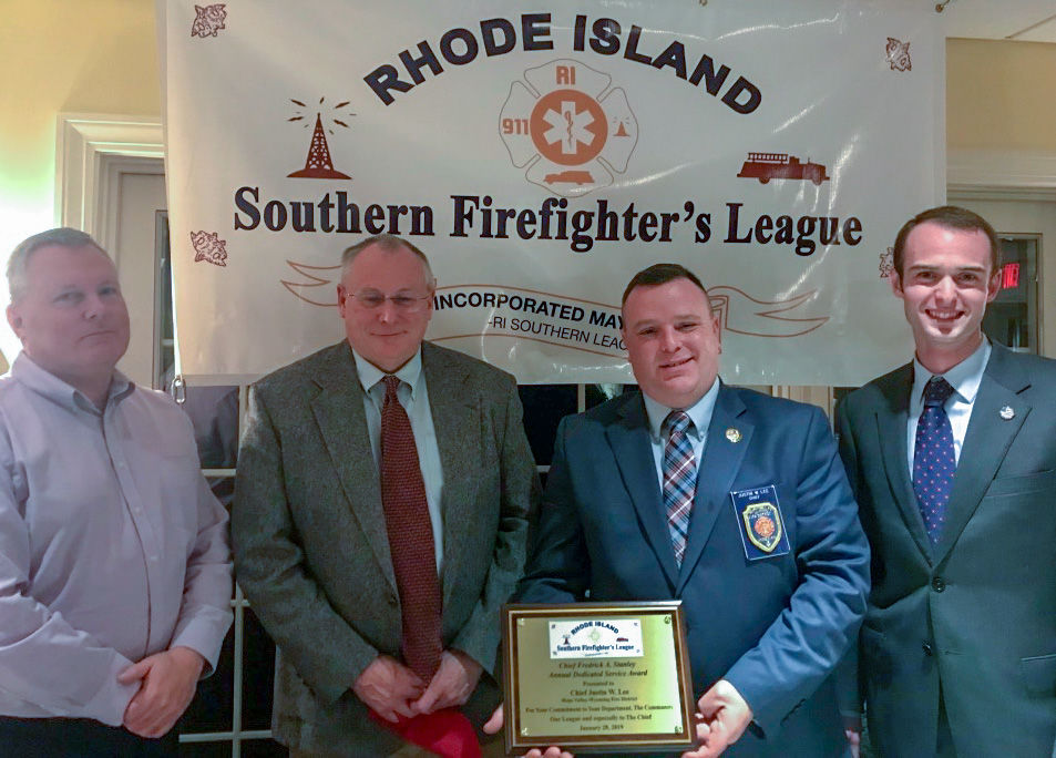 Hope Valley-Wyoming Fire Chief Justin Lee, second from right, has been named the first-ever recipient of the Frederick A. Stanley Dedicated Service Award from Rhode Island Southern Firefighter's League. Shown with Lee are, from left, Watch Hill Fire Chief Robert Peacock, Kingston Fire Chief Nate Barrington, who serves as league president, and Watch Hill Fire Lt. Christopher Koretski, the organization's secretary. Courtesy R.I. Southern Firefighter's League