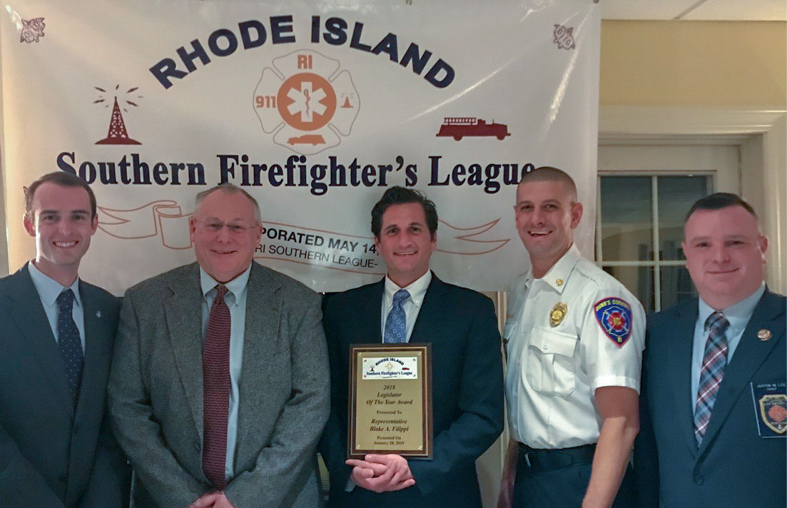 State Rep. Blake Filippi, center, stands with the 2018 Legislator of the Year Award from the from Rhode Island Southern Firefighter's League. Filippi was named the recipient during a special ceremony in January. He stands alongside, from left, Watch Hill Lt. Christopher Koretski, the league secretary; Kingston Fire Chief Nate Barrington, league president; Watch Hill Fire Chief Robert Peacock, board member; and Hope Valley-Wyoming Fire Chief Justin Lee, a board member. Courtesy R.I. Southern Firefighter's League